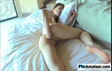 Sweet girl fisting her pussy on the bed