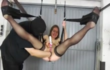 Brunette on sex swing gets fisted